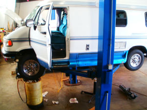 Truck Camper On Service Lift For Transmission Repair Chassis Service